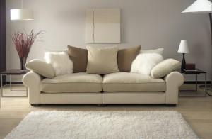cream sofa in modern living room with rug